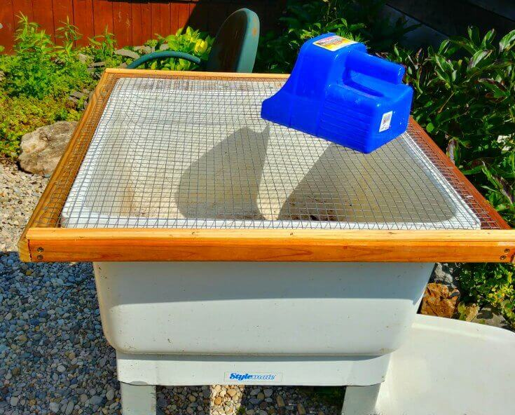 Soil bin with sifter top and chicken feed scoop