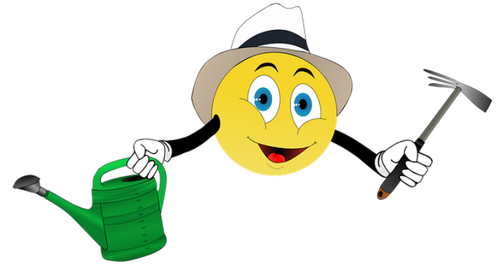 image of smiley face with hoe and watering can