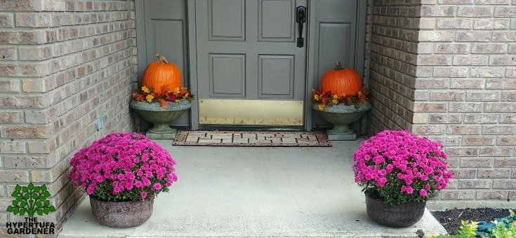 A colorful fall front porch with hypertufa saucers
