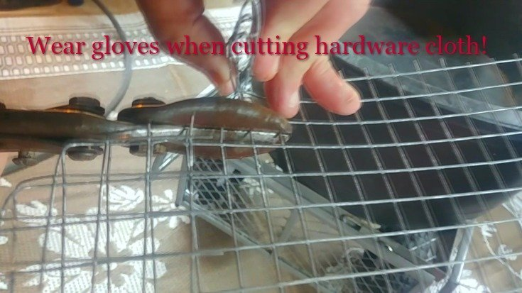 image of tin snips cutting hardware cloth