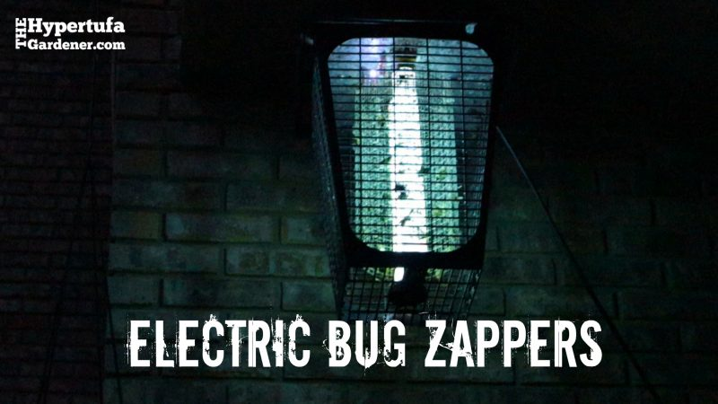 image of electric bug zapper in the dark, sparking