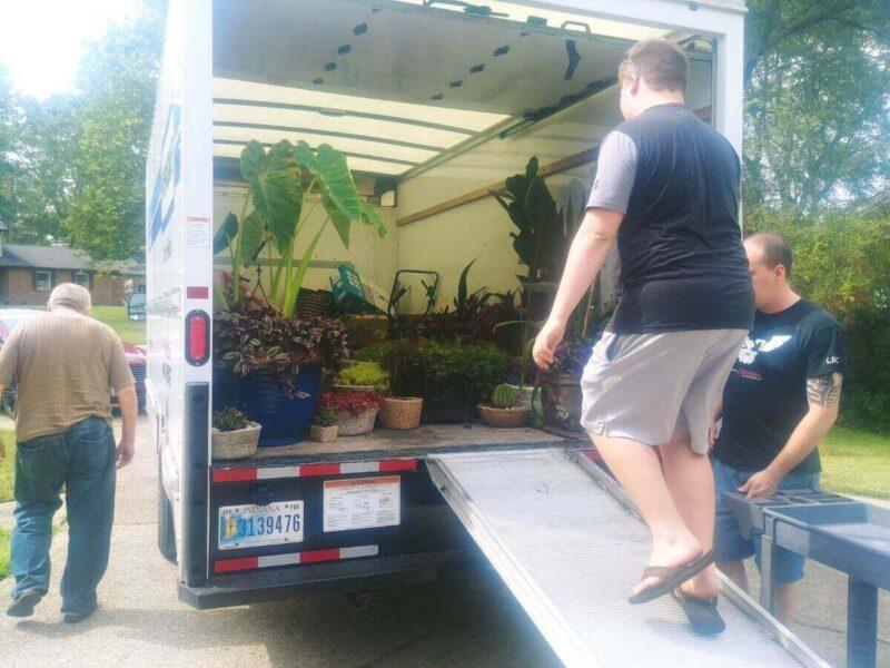 3 men loading plants into truck