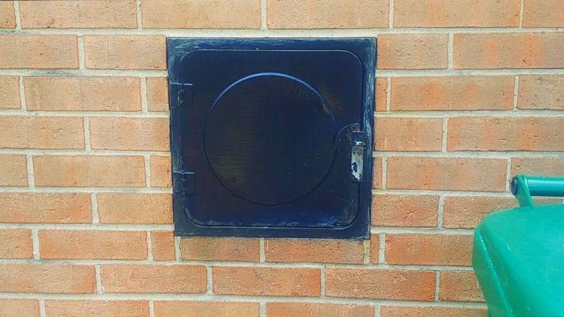 milk door in brick wall
